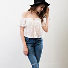 White lace overlay top. Price firm. Adorable! White lace overlay top. 76% cotton 21% polyester 3% spandex. Made in USA! April Spirit Tops