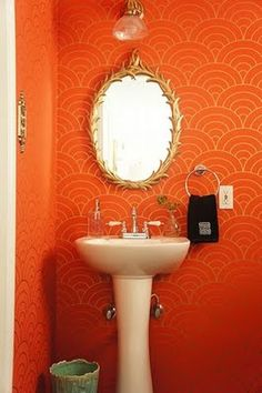 orange wallpaper....change the light fixture and pedestal, and towel ring, and we're talking.