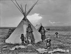 Blackfoot mother and her children photographed around the turn of the century in Montana