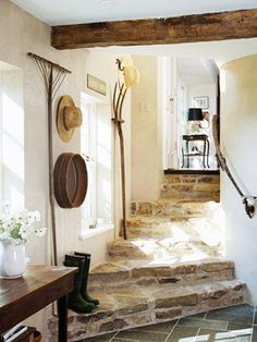 informal back entrance with flagstone steps, wood beam and unusual decorative touches such as the wall-hung wooden rake, pitchfork and sifter lMidwest Living House Design, French Cottage, Stone Stairs, Wood Beams, Cottage Design, Sweet Home, European Farmhouse, Flagstone Steps, Rustic House