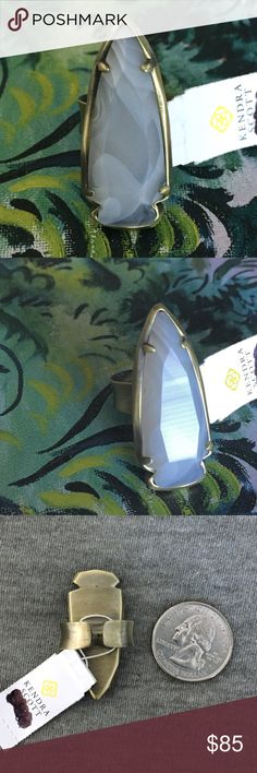 NWT Kendra Scott Kenny White Banded Agate Ring Gorgeous white banded agate shaped into a sleek arrowhead shape all set in antique brass, perfect to bring a unique twist to any outfit! Adjustable size band means one size fits most! Add to your collection or start a new one! Perfect condition, never worn! Kendra Scott Jewelry Rings