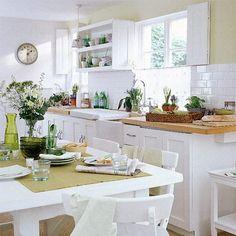 Brick wall white kitchen