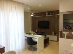 Canto da TV de um apartamento, em Ribeirão Preto. Projeto de Renata Oliveira.