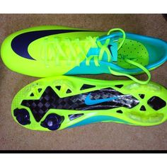 neon green and blue outdoor cleats