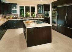 My next kitchen floor.Daltile product: Yacht Club - Photo features Topsail 6 x 24 in a staggered pattern on the floor with Stone Radiance x Random Mosaic in Morning Sun/Tortoise/Mushroom blend mosaic on the backsplash. Cabinets And Countertops, Dark Cabinets, Kitchen Cabinets, Patterned Kitchen Tiles, Wood Look Tile, Floating, Kitchen Flooring, Tile Flooring, Outdoor Flooring