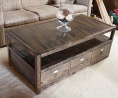 DIY coffee table with storage - Took some hunting but I found the site with the plans for this table. I would change the hardware used and the stain so it would match the rest of the living room furniture.