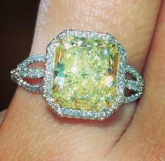 Fancy yellow radiant diamond engagement ring with diamond halo