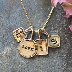 Gold Necklace with stamped initial charms.  Trinket Initial