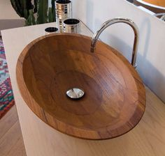Wooden bowl sink.  this could be very cool with the slate and river rocks.