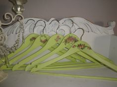 Set of (5) Sweet & Shabby Wooden Clothes Hangers.. Pale Lime Green with Roses. I could use water slide decals easily