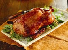 "Roasted Whole Duck - Basic Recipe. This basic roast duck recipe creates a crispy skin and moist meat.   Serving Size: 4 Servings  Ingredients:  1 Maple Leaf Farms Whole Duck (5-6 lbs), defrosted  Boiling water  1 Tbsp Kosher salt  1 1/2 tsp Freshly Ground Black Pepper  1 tsp Paprika  1 Orange, cut in quarters  1 Head Garlic, paper removed and top trimmed  2 Celery Stalks, cut into 2"" pieces"