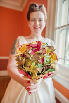 A 1950s styled bride & her paper pinwheel bouquet | From Annie & Josh's super local & alternative Washington DC wedding | Images: Knotty Photos