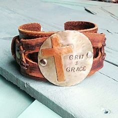 "Hand Distressed Leather Cuff Handstamped Metal Plate 2 Adjustable Straps Entire length of bracelet is 2"" by 8.5"" Adjusts with snaps from - Approx. 7.25"" to 7.75"""