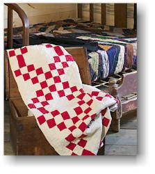 """""""Nine Patch"""" quilt made by Laura Ingalls Wilder and her daughter, Rose."""