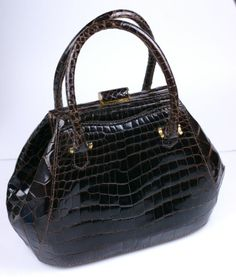 Unusual Center Cut Alligator Bag | From a collection of rare vintage handbags and purses at http://www.1stdibs.com/fashion/accessories/handbags-purses/