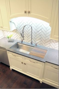 Kitchen-152-680x1024  love the herringbone=