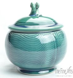This beautiful teal pottery covered bowl can be used as a condiment or sugar bowl, and adds a touch of color where ever you place it. Handmade in America by Russel Spillmann.