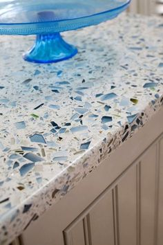 recycled glass countertop  I'm loving the blue glass cake stand