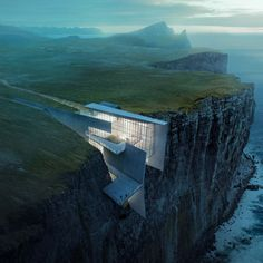This daring concrete retreat carved into the cliffside in Iceland looks like a natural extension of the rough landscape. Architect and artist Alex Hogrefe designed the building as a reflection of the country's craggy glaciers with enviable ocean views. Architecture Cool, Architecture Visualization, Concrete Architecture, Architecture Memes, Architecture Portfolio, Historical Architecture, Residential Architecture, Contemporary Architecture, Contemporary Design
