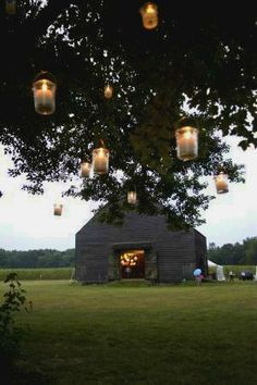 Like this idea for a country wedding - could hang these in the pecan orchard where the ceremony will take place...Candles hanging from trees--well, here's a pro for having the wedding in the Boston area: we won't start a huge forest fire!