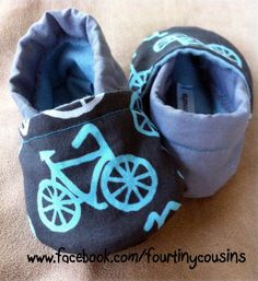 Soft shoes for baby or toddler boys in gray and blue with vintage bikes by Michael Miller