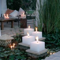 Create the same look with Candle Impressions Outdoor Flameless Candles. Ease the lighting process by using the remote control option! Metal Lanterns, Candle Lanterns, Flameless Candles, Pillar Candles, Chandeliers, Square Candles, Personalized Candles, Backyard Lighting, Mood Light