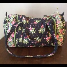 Vera Bradley Small Duffel Vera Bradley small duffel - new Hope (retired pattern). Small stains on inside bottom of bag (conditioner spilled!). Otherwise great shape-no rips. Smoke free home. Pets in home but bags have been washed.   Also selling matching large duffel and hanging garnet bag. Will bundle. Vera Bradley Bags Travel Bags