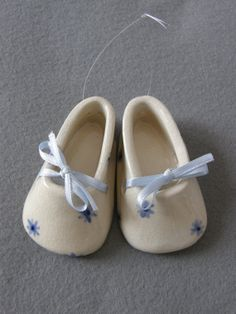 Shop Etsy, the place to express your creativity through the buying and selling of handmade and vintage goods. Ceramic Shoes, Baby Shower Crafts, Baby Presents, Gifts For New Parents, White Clay, Boy Blue, Blue Flowers, Sculpture, Baby Shoes