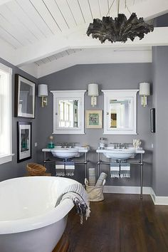 "Gray's air of elegance can elevate more-casual decor choices, such as industrial-style fixtures and fouta towels, in the master bath. It also tends to be a bit easier on the eye than adding more stark white to the space. We especially love the way subtle bits of warm brass in the form of fixtures or even frames work with gray's blue undertones. See more interior design ideas on ""Gray Rooms We're Loving Right Now"" on the One Kings Lane Style Guide!"