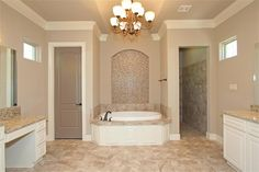 1334 Autumnwood Magnolia, TX 77354: Photo Look at this Master bath! Barrel vaulted ceiling with chandelier and niche behind tub is filled with sparkling glass tile!