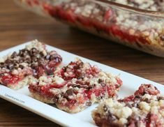 These strawberry chocolate chip crumble bars combine chopped fresh strawberries, preserves and a crumbly oat topping into a delicious bar cookie dessert!