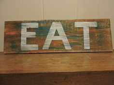 EAT wood pallet sign custom hand painted by MittenGirlzDesigns