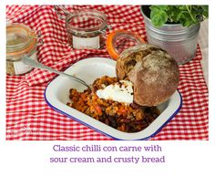 Classic chilli con carne with sour cream and crusty bread Beef Dishes, Sour Cream, Bread, Meals, Dinner, Classic, Recipes, Food, Dining
