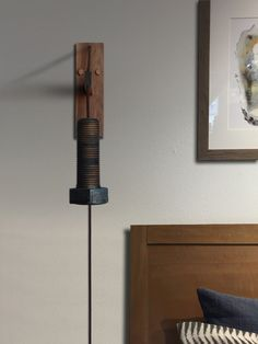 This unique industrial ceramic and wood bolt wall sconce compliments the design of any room. Comes complete and ready to install with a cord mounted on/off switch. Height and length are adjustable. Wall mount is made from solid Walnut. Unique Home Decor, Wall Sconces, Wall Mount, Door Handles, Bulb, Bronze, Sculpture, Ceramics, Compliments