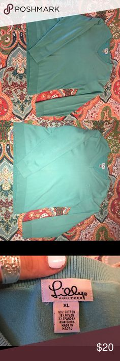 "Vintage Aqua Lilly Pulitzer Sweater Very pretty aqua color, vintage Lilly. Small stain on front, but as you can see it is not noticeable. It's a women's XL but fits me well, I'm 5'7"" and normally a medium to large. Lilly Pulitzer Sweaters Crew & Scoop Necks"