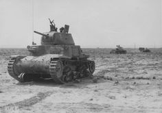 A number of Italian M13/40 tanks traveling thru the desert in occupied North Africa territory.