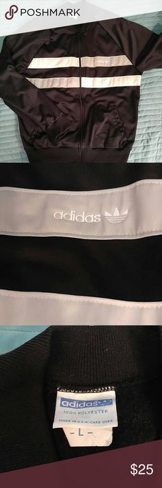Vintage Adidas black track jacket L Vintage authentic track jacket by Adidas. This jacket features a functional front zipper and silver/white stripes with an Adidas script/trefoil logo on the breast.  Item features some very light wear on the light colored stripes but is in absolutely great shape especially for a vintage item with no rips, pilling, stains or tears. Don't miss out on this rare item from the hottest brand in the world right now! Adidas Jackets & Coats Performance Jackets