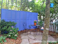 Colourful, quick, inexpensive - what a great way to add a little privacy to your outside dining/breakfast area! I imagine you could also use old doors found at a reclamation store.