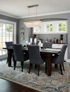 Dining room with dark wood floors,  beautiful patterned rug and blue chairs and dark wood table, Benjamin Moore Deep Silver 2124-30.