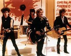 The Alarm grew out of the Punk band Alarm Alarm which was formed by Mike Peters. Forming officially in 1981, they are still going strong today, but with less hair!