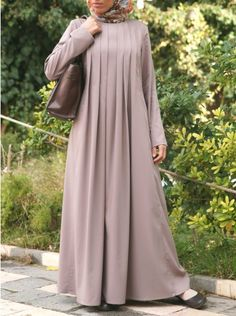 Stunning on any body type, the Long Pleated Abaya is your perfect everyday outfit. With unmatched comfort, ease of movement, and modesty, wear this abaya absolutely anywhere and everywhere! Abaya Mode, Mode Hijab, Abaya Designs, Islamic Fashion, Muslim Fashion, Abaya Fashion, Fashion Dresses, Hijab Stile, Hijab Fashionista