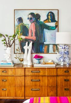 vibrant art, leg sculptures, brass trinkets, blue and white elephant lamp & vintage wood drawers #homedecor #interiordesign