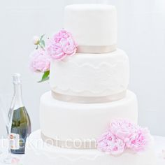 Fondant-lace bands, ribbon and fresh peonies gave the wedding cake a fresh look.