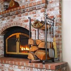 """Enclume's hearth products are constructed with Enclume's signature """"hammered steel"""". Combine this unique finish with hand-forged rolled ends, arches and other exclusive features and the result is distinctively Enclume. Cottage Fireplace, Fireplace Logs, Fireplace Tool Set, Fireplace Design, Firewood Rack Plans, Indoor Firewood Rack, Firewood Storage, Fireplace Dimensions, Wood Fire Pit"""