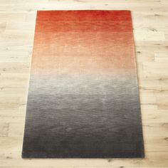 Shop bicoastal rug.   Hand-woven from a wool/cotton blend, plush pile runs the spectrum from orangish pink to charcoal grey creating a rich heathered effect.  Earthy palette grounds the room in depth and interest––a modern step up from the standard solid.