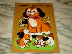 vintage Fisher Price dogs and puppies wooden peek and play puzzle number 511 in minty condition. $22.00, via Etsy.