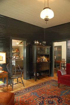 dark colors — like the smoky charcoal pictured here — bring great warmth, interest and, yes, color to a room.