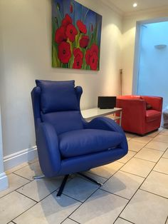 Bright bold blue leather swivel chair for a large airy space.
