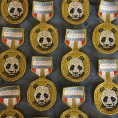 Part of the Coral and Tusk medal series, the panda medal pin is award-able for a variety of civil contributions!