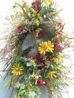 Primitive Rustic Country Fall Door Wreath Arrangement, Crow, Pumpkin, Wild and Whispy. $49.99, via Etsy.